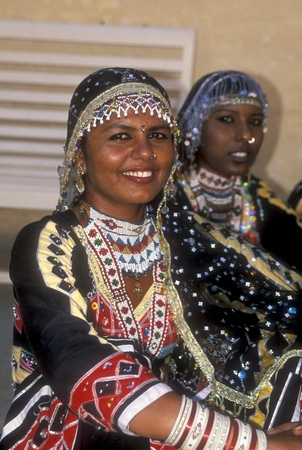 Jodhpur, India - October 5, 2006: Beautiful Kalbelia dancer in ornate black costume trimmed with beads and sequins at the annual Marwar festival in Jodhpur, Rajasthan, India