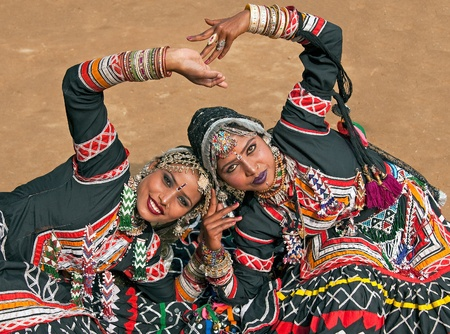 haryana: Haryana, India - February 12, 2009: Kalbelia dancers in ornate black costume trimmed with beads and sequins at the Sarujkund Fair near Delhi in India Editorial