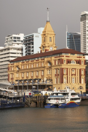 Auckland, New Zealand - June 24, 2008: Historic Ferry Building and quay on the water front in Auckland, New Zealand