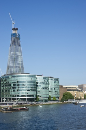 London, England - July 24, 2011: The Shard under construction at London Bridge on the River Thames in London, England. When complete it will be the tallest building in the European Union. Stock Photo - 10007462