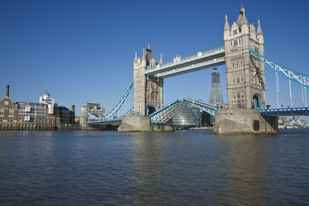 Tower Bridge open to allow ships and boats to pass  River Thames in London, England photo