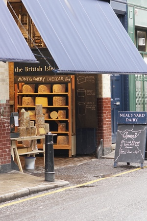 London, England - December 31, 2009: Neals Yard Dairy selling cheese at Borough Market in Southwark, London, England.