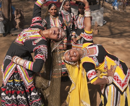 Delhi, India - February 11, 2008: Female kalbelia dancers performing at the annual Sarujkund Fair on the outskirts of Delhi in India.