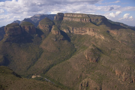The Three Rondavels on an escarpment in the Blyde River Canyon Nature Reserve in Mpumalanga, South Africa photo