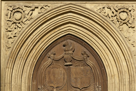 Large wooden door set in the west front facade of Bath Abbey. 16th Century church, Bath, England, United Kingdom photo