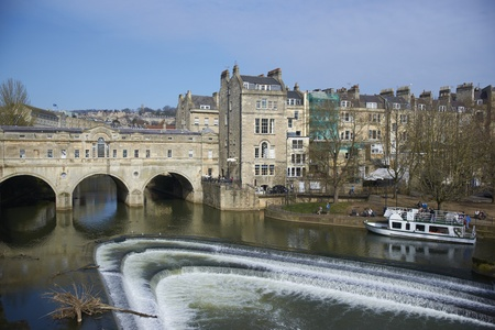 Bath, United Kingdom - March 20, 2011: Historic Pulteney Bridge across the River Avon in Bath, Somerset, England.