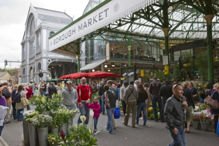 London, United Kingdom - May 14, 2011: Crowds of people at the historic Borough Market in Southwark, London, England.