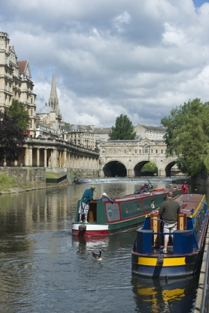 Bath, England - May 31, 2011: Canal boats on the River Avon in Bath, Somerset, England