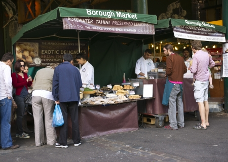 London, United Kingdom - July 23, 2011: People shopping at the historic Borough Market in Southwark, London, England.