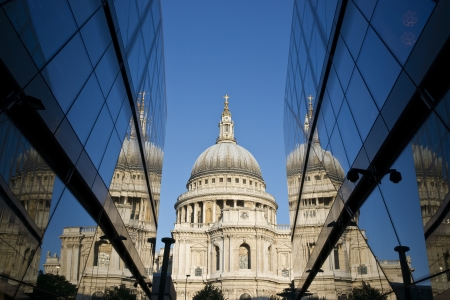 St Pauls Cathedral reflected in the glass walls of a modern building in London, England Stock Photo - 14390302