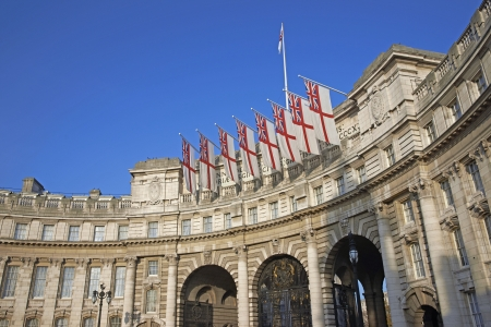 London, United Kingdom - November 20, 2011: Admiralty Arch decorated with White Ensign flags in central London, England, United Kingdom.