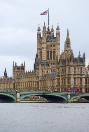 London, United Kingdom - June 4, 2012: Houses of parliament tower above Westminster Bridge over the River Thames in London, England, United Kingdom.