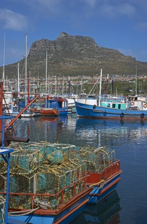 Houts Bay, South Africa - September 15, 2011: Fishing boats in the harbor at Houts Bay in South Africa