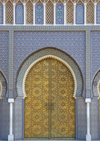 Fes, Morocco - October 18, 2012: Ornate entrance gates to the Royal Palace in Fes, Morocco