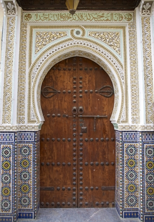 Old door in the historic medina in the ancient city of Fes in Morocco photo