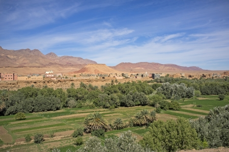 foothills: Traditional Berber village and cultivated fields along a river valley in the foothills of the Atlas Mountains in Morocco