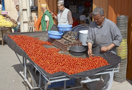Taroudant, Morocco - October 24, 2012: Man selling tomatoes from a hand cart in the ancient town of Taroudant in Morocco.