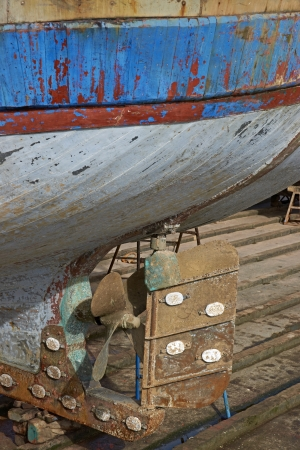 slipway: The rudder of a large fishing boat on a slipway in the historic harbour of Essaouira in Morocco