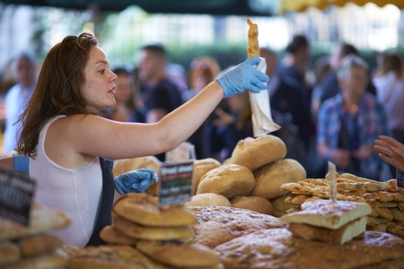 London, United Kingdom - August 11, 2012 Market stalls selling bread at Borough Market in London, England