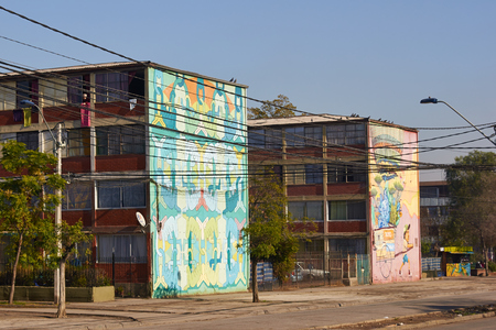 tenement: Santiago, Chile - June 13, 2014  Colourful murals adorning the walls of tenement blocks in the San Miguel area of Santiago, capital of Chile  The area was created as an open air museum in what was a run down area of the city  Editorial