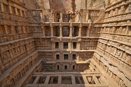step well: Ornate stone carved walls lining the 11th century Rav-Ki-Vav stepwell at Patan, Gujarat, India  Selected as a UNESCO world Heritage Site in June 2014