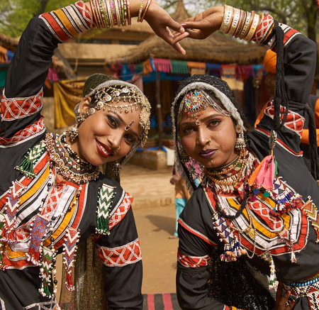 Haryana, India - February 12, 2009  Beautiful Kalbelia dancers in ornate black costumes trimmed with beads and sequins at the annual Sarujkund Fair near Delhi, India