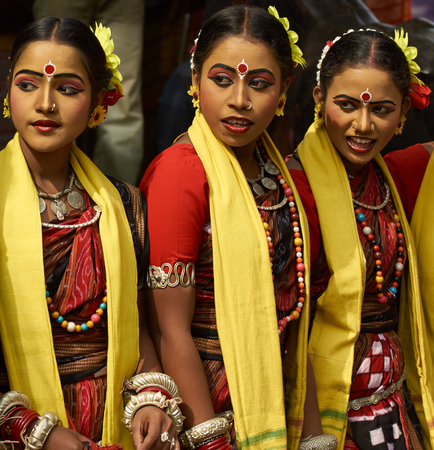 Haryana, India - February 12, 2009  Group of teenage Indian dancers in traditional tribal outfits at the Sarujkund Craft Fair in Haryana near Delhi, India