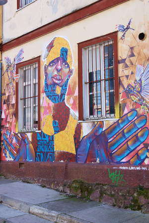 valparaiso: Valparaiso, Chile - July 23, 2014  Colourful urban art decorating a street in the world heritage city of Valparaiso in Chile Editorial