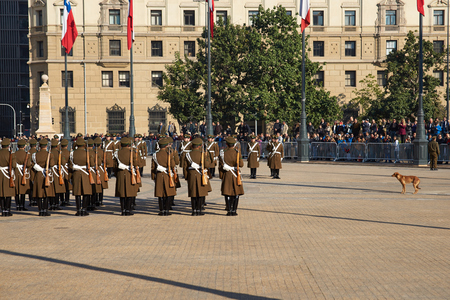 Santiago, Chile - July 25, 2014  Members of the Carabineros performing the changing of the guard ceremony at La Moneda in Santiago, Chile