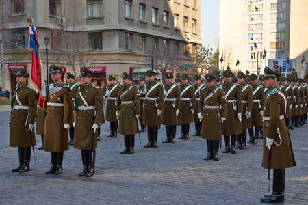 paramilitary: Santiago, Chile - July 25, 2014  Members of the Carabineros performing the changing of the guard ceremony at La Moneda in Santiago, Chile Editorial