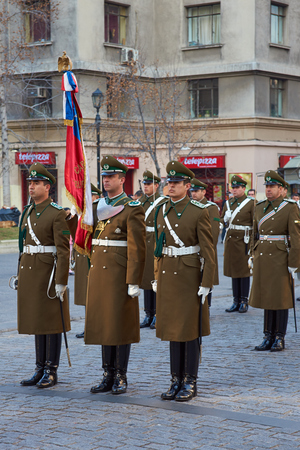 Santiago, Chile - July 25, 2014  Members of the Carabineros performing the changing of the guard ceremony at La Moneda in Santiago, Chile Editorial