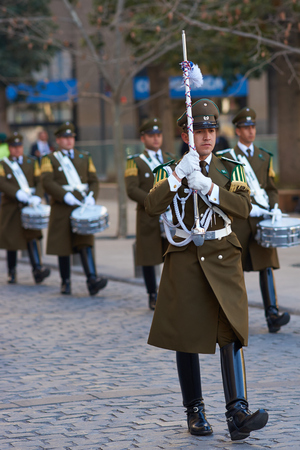 Santiago, Chile - August 8, 2014  Leader of the Carabineros Band marching as part of the changing of the guard ceremony at La Moneda in Santiago, Chile