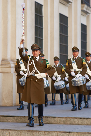 paramilitary: Santiago, Chile - August 8, 2014  Members of the Carabineros Band marching as part of the changing of the guard ceremony at La Moneda in Santiago, Chile