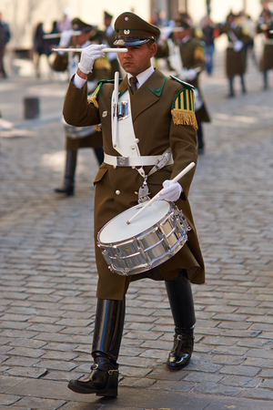 paramilitary: Santiago, Chile - August 12, 2014  Member of the Carabineros Band marching and playing the drum as part of the changing of the guard ceremony at La Moneda in Santiago, Chile Editorial