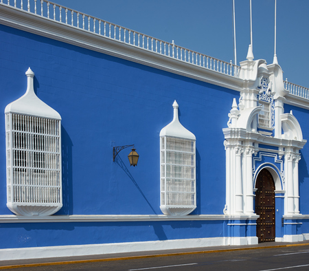 Bright blue and white Spanish colonial style building in the Plaza de Armas in the centre of Trujillo in northern Peru. photo