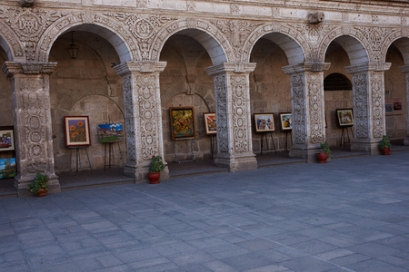 Arequipa, Peru - August 23, 2014: Local artists selling paintings in one of the courtyards of the historic Jesuit church Iglesia de la Compania in Arequipa, Peru