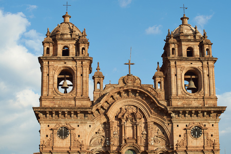 Ornate facade of the historic Iglesia de la Compania in the Plaza de Armas of Cusco in Peru. The church dates back to 1571 and sits on top of an old Inca Palace Stock Photo