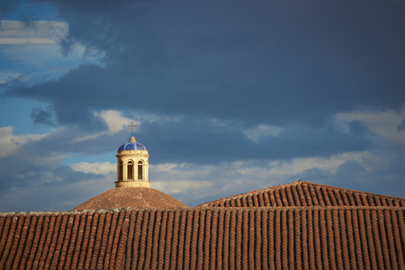 Dome of the historic Convent Santa Catalina rises above the red tiled roofs of Cusco in Peru. photo