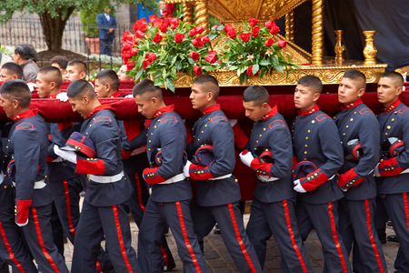 patron: Cusco, Peru - August 30, 2014: Police officers in best uniform carry a statue of Saint Rose through the streets of Cusco in Peru as part of the annual festival. In Peru, Saint Rose is the patron saint of the police and armed forces.