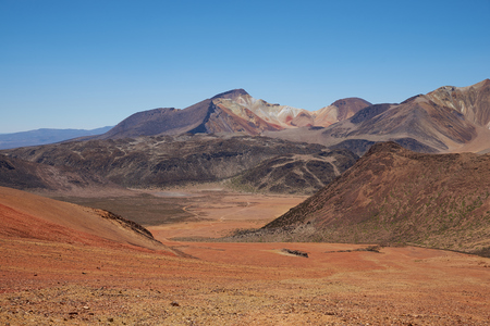 metres: Colourful mountain landscape at Suriplaza in the Atacama Desert of north east Chile. The altitude is in excess of 4,000 metres. Stock Photo
