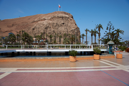 vicuna: High cliff of Morro de Arica towering above Plaza Vicuna Mackenna in the heart of the port city of Arica in Chile.
