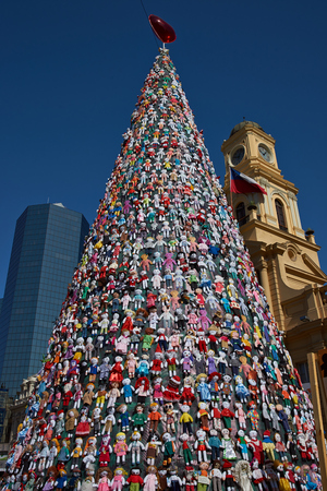 Santiago, Chile - December 19, 2014: Christmas tree decorated with hundreds of rag dolls in the Plaza de Armas, Santiago, capital of Chile. Editorial