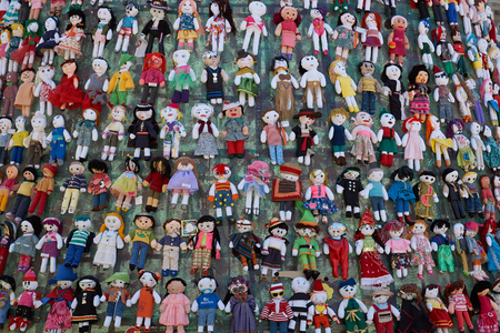 symbolic: Santiago, Chile - December 19, 2014: Detail of some of the hundreds of rag dolls decorating a Christmas tree in the Plaza de Armas, Santiago, capital of Chile.