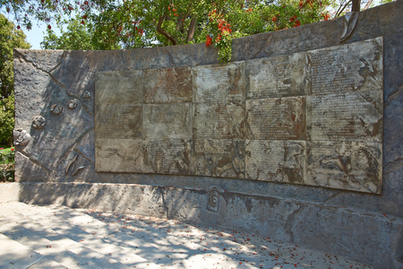 detained: Santiago, Chile - November 19, 2014: Wall of names in Villa Grimaldi in Santiago, Chile. Memorial park to the people who were detained and tortured during the 1970\