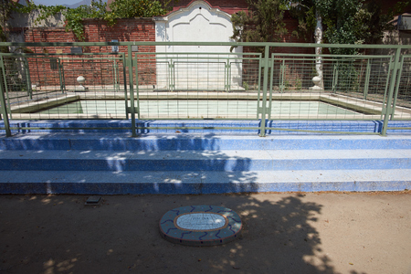 tortured: Santiago, Chile - November 19, 2014: Swimming pool in Villa Grimaldi in Santiago, Chile. Memorial park to the people who were detained and tortured during the 1970s in the prison camp located on this site during the military dictatorship.