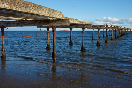 magellan: Historic pier on the waterfront of Punta Arenas running along the Magellan Strait in Patagonia, Chile Stock Photo