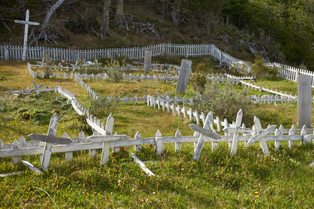 inhabit: Cemetery of the the Yaghan people on Navarino Island in Tierra del Fuego, southern Chile. The Yaghan are the nomadic indigenous people that used to inhabit the tip of South America.