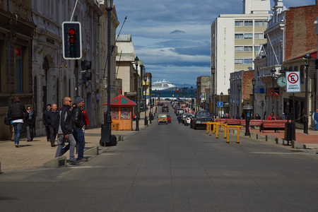 strait of magellan: Punta Arenas, Chile - November 26, 2014: Street leading to the Magellan Strait and passing ship in Punta Arenas, southern Chile. Editorial