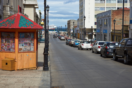arenas: Punta Arenas, Chile - November 26, 2014: Street leading to the Magellan Strait and passing ship in Punta Arenas, southern Chile. Editorial