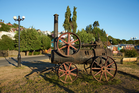 castro: Old steam engine in a coastal garden in Castro, capital of the Island of Chiloe in southern Chile.